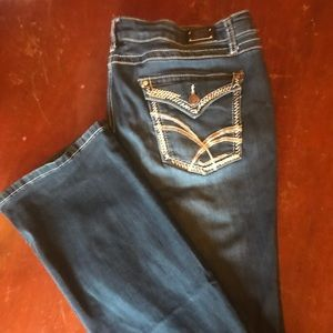 Women's slim boot style jeans with fancy pockets